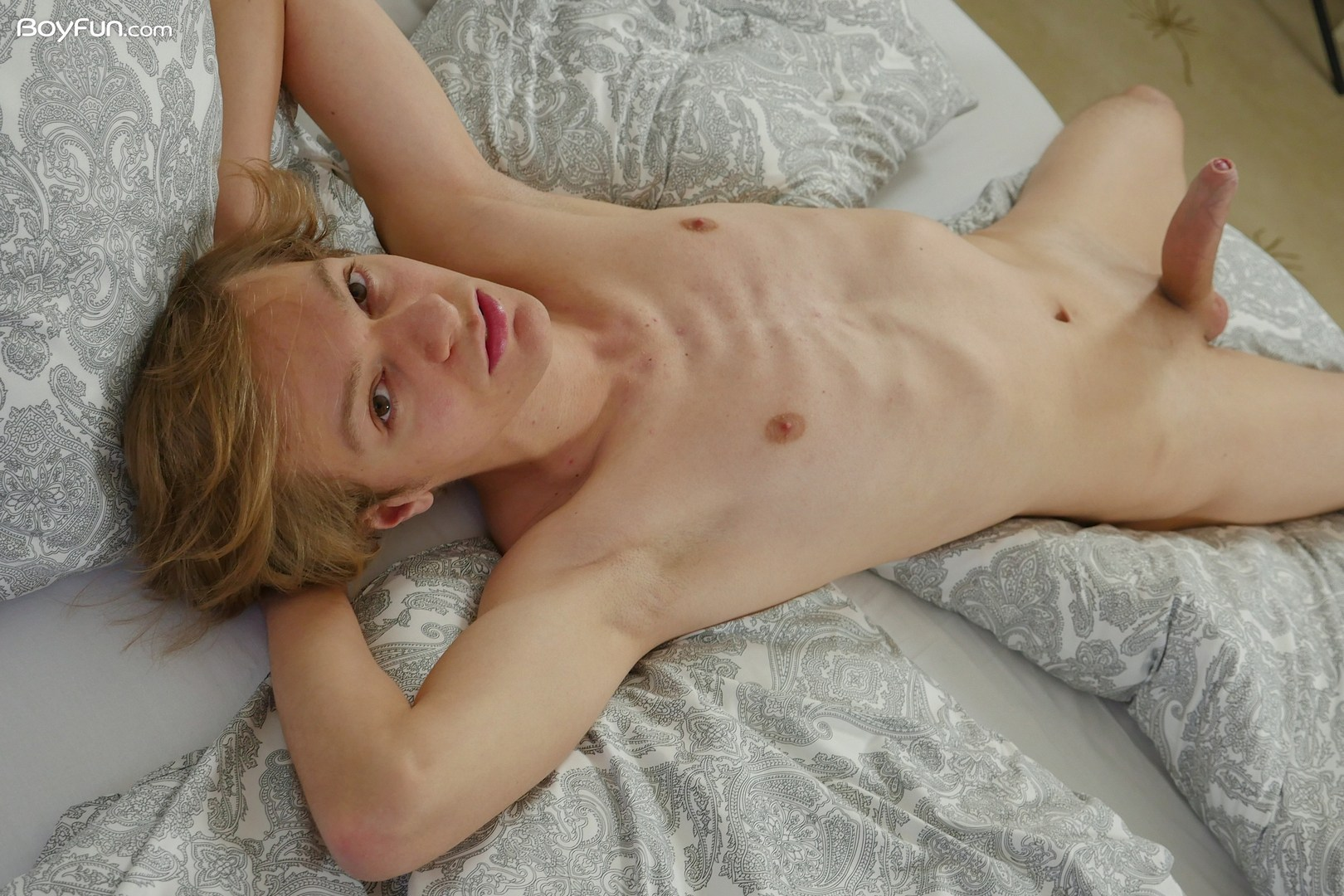 Blonde boy with a big smooth shaved cock