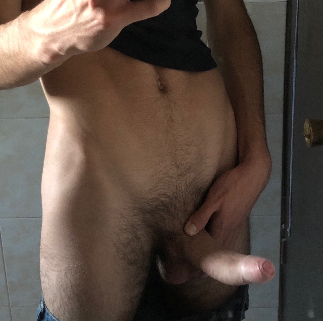 Boy with a hard uncut cock