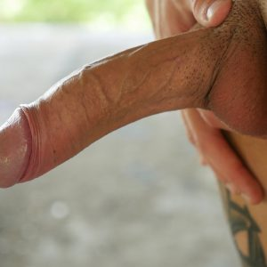 Cute gay boy showing his big uncut cock