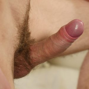 Cute boy with a hairy uncut cock