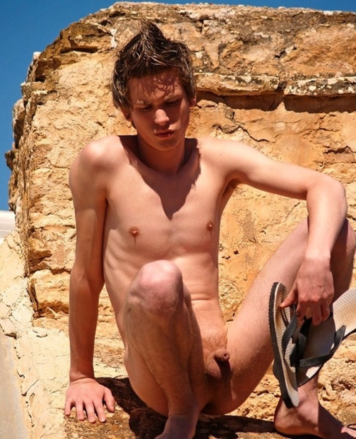 Cute nude boy outdoors