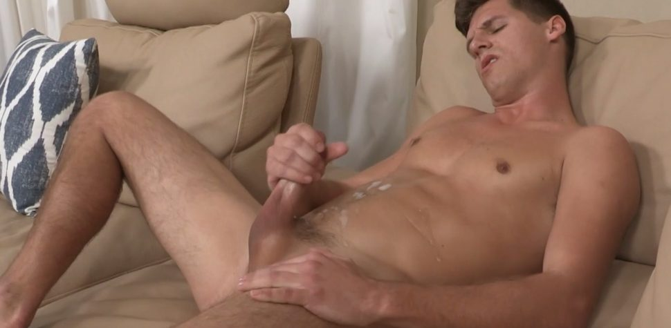 Nude twinks whacking off on a sofa