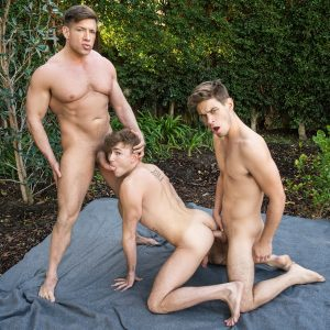 Gay men having a threesome outdoors