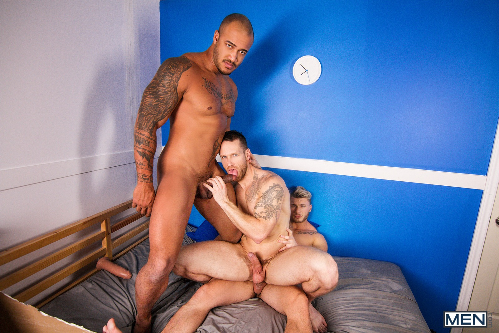 Nude gay men having a threesome