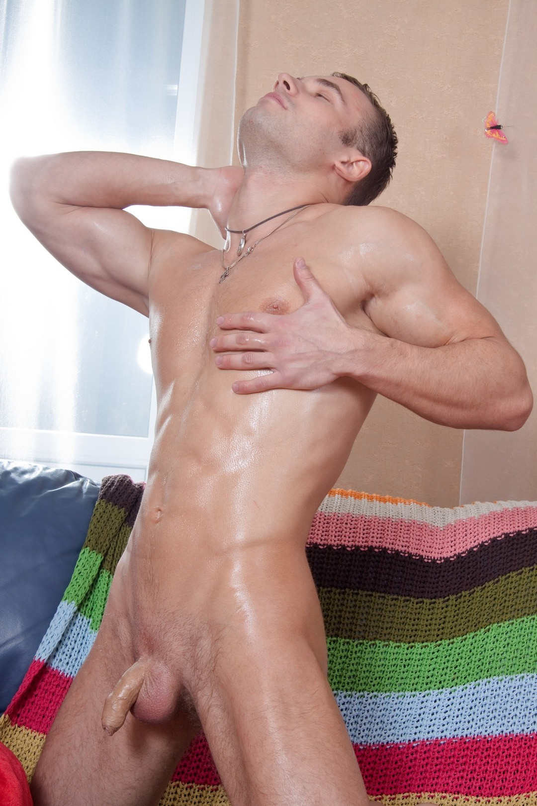 Muscular man with a soft uncut cock