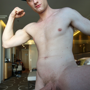 Nude erected boy flexing