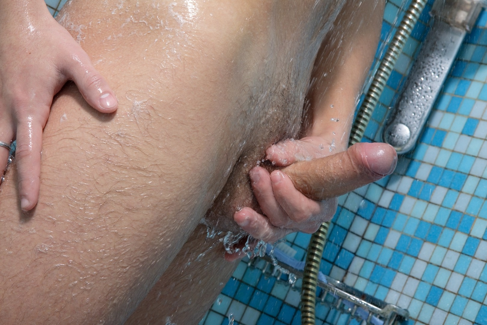 Nude uncut boy jerking off in the shower