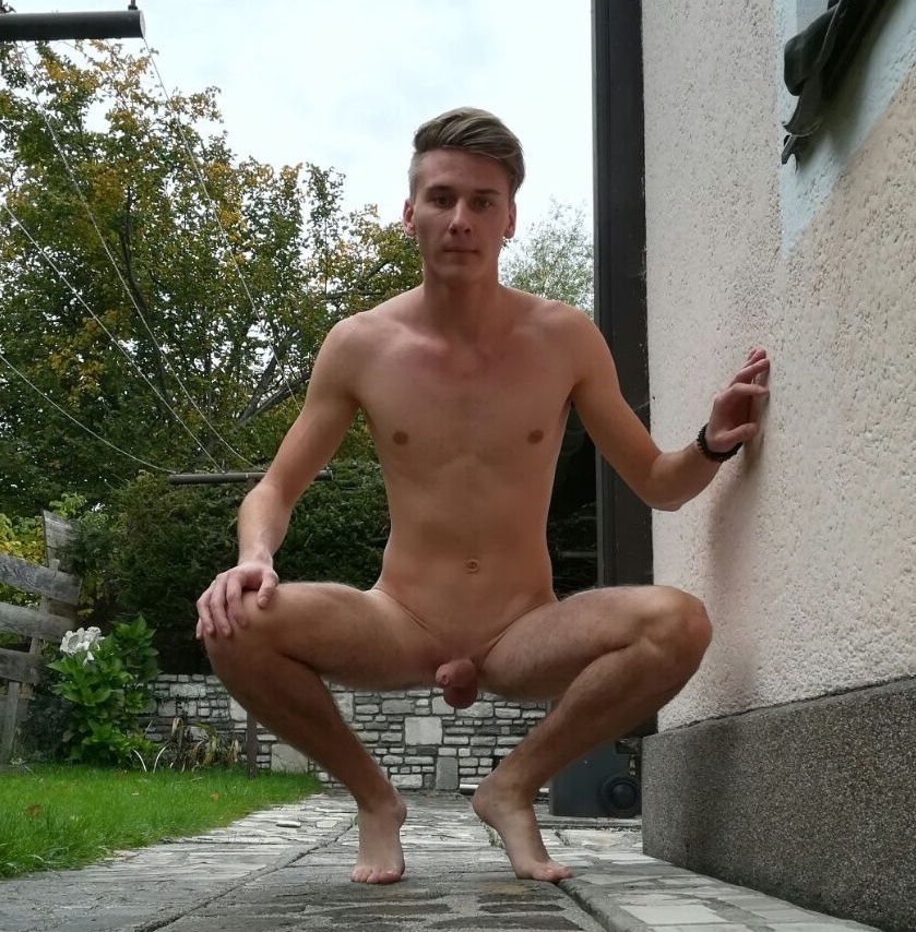 Nude boy outdoors