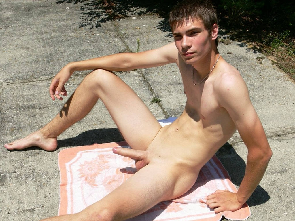 Nudist boy with a big erection
