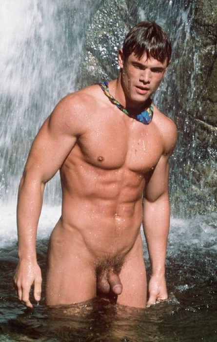 Nudist muscle man in the water