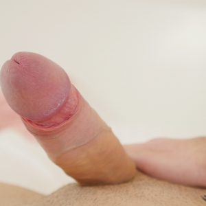 Sexy boy stripping and showing shaved cock