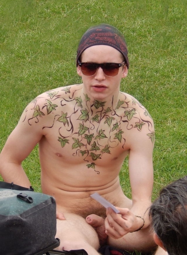 Tattooed nudist boy in public