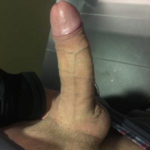 Uncut cock with trimmed pubes